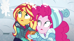 Size: 1920x1080   Tagged: safe, screencap, pinkie pie, sunset shimmer, equestria girls, equestria girls series, holidays unwrapped, saving pinkie's pie, spoiler:eqg series (season 2), clothes, duo, female, jacket, mittens, ramekin, snow, snow fort, snowball fight, souffle, winter hat, winter jacket, winter outfit