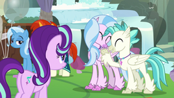 Size: 1920x1080 | Tagged: balloon, brother and sister, female, hippogriff, hug, male, mare, safe, screencap, siblings, silverstream, spoiler:s09e11, starlight glimmer, student counsel, sunburst, terramar, tree, trixie, unicorn