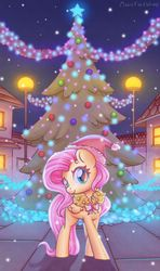 Size: 1600x2702 | Tagged: safe, artist:musicfirewind, fluttershy, pegasus, pony, christmas, christmas tree, christmas wreath, cute, female, folded wings, hat, head turn, holiday, looking at you, mare, night, outdoors, santa hat, shyabetes, smiling, solo, standing, tree, wings, wreath