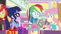 Size: 1920x1080 | Tagged: applejack, bad gift wrapping, beverage, canterlot mall, dashing through the mall, drink, equestria girls, equestria girls series, female, fluttershy, food, geode of fauna, geode of super speed, geode of telekinesis, gift box, gift giving, glasses, holidays unwrapped, magical geodes, orange, present, rainbow dash, safe, sci-twi, screencap, spoiler:eqg series (season 2), strawberry, sunset shimmer, twilight sparkle