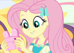 Size: 1507x1080 | Tagged: bunny ears, camera, canterlot mall, chair, clothes, cropped, cute, dashing through the mall, dress, equestria girls, equestria girls series, female, female focus, fluttershy, geode of fauna, hairclip, happy, holidays unwrapped, jewelry, looking down, magical geodes, mall, necklace, present, safe, screencap, shyabetes, sitting, solo, solo female, solo focus, spoiler:eqg series (season 2)
