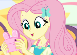 Size: 1511x1080 | Tagged: bunny ears, camera, canterlot mall, chair, clothes, cropped, cute, dashing through the mall, dress, equestria girls, equestria girls series, female, female focus, fluttershy, geode of fauna, hairclip, happy, holidays unwrapped, jewelry, looking down, magical geodes, mall, necklace, present, safe, screencap, shyabetes, sitting, solo, solo female, solo focus, spoiler:eqg series (season 2)