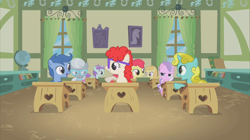 Size: 2880x1618 | Tagged: safe, screencap, apple bloom, archer (character), diamond tiara, liza doolots, noi, petunia, scootablue, silver spoon, sun glimmer, tootsie flute, twist, earth pony, pegasus, pony, unicorn, call of the cutie, background pony, classroom, desk, female, filly, foal, ponyville schoolhouse