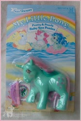 Size: 408x610 | Tagged: safe, fizzy, surf rider, sea pony, beachcomber (g1), bow, comb, mane bow, official, packaging, pretty and pearly baby sea ponies, ripple (g1), toy, you had one job