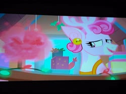 Size: 4160x3120   Tagged: safe, screencap, bori the reindeer, deer, reindeer, best gift ever, bell, boxes, discovery family logo, ear piercing, earring, gift box, glow, happy, holly, jewelry, lights, looking back, picture of a screen, piercing, ribbon, television
