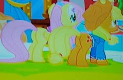 Size: 2784x1831 | Tagged: safe, screencap, applejack, fluttershy, pegasus, pony, best gift ever, butt, duo, duo female, earmuffs, female, from behind, looking forward, outdoors, picture of a screen, plot, plot pair