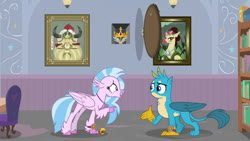 Size: 1280x720 | Tagged: safe, edit, edited screencap, screencap, aurora (character), gallus, silverstream, yickslur, classical hippogriff, griffon, hippogriff, yak, a matter of principals, amulet, amulet of aurora, beak, beakless, bookshelf, bust, cartoon physics, chair, crown, crown of grover, duo, got your nose, helm of yickslur, helmet, implied king grover, jewelry, library, modular, no mouth, open beak, painting, portrait, regalia, school of friendship, story included
