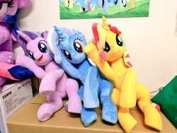 Size: 1024x768 | Tagged: safe, artist:nekokevin, applejack, fluttershy, pinkie pie, rainbow dash, rarity, starlight glimmer, sunset shimmer, trixie, twilight sparkle, pony, unicorn, series:nekokevin's glimmy, cute, diatrixes, female, glimmerbetes, irl, looking at you, magical trio, mare, open mouth, party cannon, photo, plushie, poster, raised hoof, shimmerbetes, sitting, smiling, underhoof, unicorn twilight