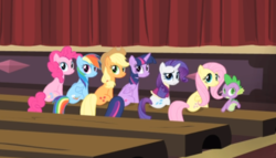 Size: 693x396 | Tagged: alicorn, applejack, cropped, earth pony, female, fluttershy, looking back, mane seven, mane six, mare, pegasus, pinkie pie, pony, rainbow dash, rarity, rarity takes manehattan, rear view, safe, screencap, sitting, smiling, spike, theater, twilight sparkle, twilight sparkle (alicorn), unicorn