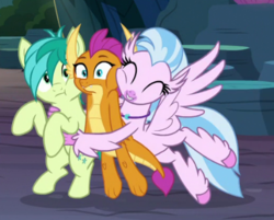 Size: 449x361 | Tagged: safe, screencap, sandbar, silverstream, smolder, classical hippogriff, dragon, earth pony, hippogriff, pony, uprooted, cheek squish, cropped, cute, diastreamies, eyes closed, glomp, group hug, hug, male, sandabetes, smolderbetes, squishy cheeks, trio