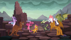 Size: 2000x1123 | Tagged: safe, screencap, baff, ballista, barry, billy (dragon), fizzle, princess ember, prominence, rex (dragon), smolder, dragon, uprooted, arm wrestling, background dragon, cheering, dragon lands, dragoness, female, male, smiling, teenaged dragon