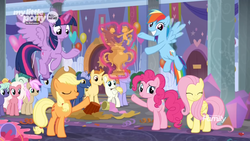 Size: 1366x768 | Tagged: safe, screencap, applejack, fluttershy, rainbow dash, twilight sparkle, alicorn, earth pony, pony, she's all yak, spoiler:s09e07, bucket, confetti, crowd, cute, eyes closed, female, flying, glowing horn, horn, levitation, magic, mare, mess, party, pointing, raised eyebrow, raised hoof, reward, spread wings, streamers, telekinesis, trophy, twilight sparkle (alicorn), wide grin, wings