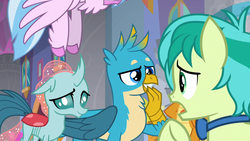 Size: 1280x720   Tagged: safe, screencap, gallus, ocellus, sandbar, silverstream, smolder, changedling, changeling, classical hippogriff, dragon, hippogriff, she's all yak, amused, bowtie, claws, confused, curved horn, dragoness, female, flapping, folded wings, grin, hand over mouth, hooves, horn, male, offscreen character, open mouth, raised arm, raised eyebrow, raised hoof, smiling, smirk, spread wings, talking, talons, teenaged dragon, teenager, trio focus, unshorn fetlocks, wings