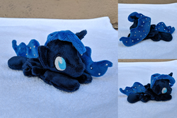 Size: 2382x1588 | Tagged: safe, artist:plushbyanto, princess luna, alicorn, pony, beanie (plushie), chibi, ethereal mane, female, horn, irl, lying down, mare, minky, no mouth, no nostrils, no pupils, photo, plushie, profile, prone, solo, sploot, starry mane, toy, wings
