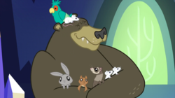 Size: 2100x1177 | Tagged: safe, screencap, harry, bear, bird, ferret, mouse, popinjay, rabbit, squirrel, castle sweet castle, animal, eyes closed, hug, male, sitting on head