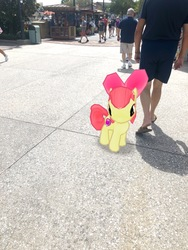 Size: 3024x4032   Tagged: safe, photographer:undeadponysoldier, apple bloom, earth pony, human, pony, augmented reality, building, cute, disney springs, disney world, downtown disney, female, filly, florida, gameloft, irl, irl human, looking at you, orlando, photo, ponies in real life, trash can, tree