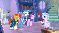 Size: 1920x1080 | Tagged: safe, screencap, edith (cockatrice), maud pie, mudbriar, silverstream, starlight glimmer, sunburst, terramar, trixie, classical hippogriff, cockatrice, earth pony, hippogriff, pony, unicorn, student counsel, spoiler:s09e11, book, cape, clothes, dragging, female, gritted teeth, hat, male, mare, petrification, rockbriar, stallion, statue, treehouse of harmony, wizard hat