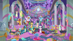 Size: 1280x720 | Tagged: alicorn, applejack, background pony, banner, bucket, changedling, changeling, classical hippogriff, colored hooves, cowboy hat, dj scales and tail, dragon, dragoness, earth pony, female, fluttershy, flying, food, gallus, griffon, hat, hippogriff, jewelry, male, mane seven, mane six, mare, necklace, ocellus, pegasus, pinkie pie, pony, rainbow dash, rarity, safe, sandbar, school of friendship, screencap, she's all yak, silverstream, smolder, spike, spoiler:s09e07, stallion, statue, teenager, twilight sparkle, twilight sparkle (alicorn), unicorn