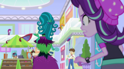 Size: 1280x718 | Tagged: safe, screencap, carlos thunderbolt, curly winds, juniper montage, mystery mint, scribble dee, some blue guy, sophisticata, starlight glimmer, velvet sky, wiz kid, equestria girls, mirror magic, spoiler:eqg specials, background human, behind, canterlot mall, female, giantess, juniper monstar, macro, male, mirror