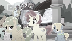 Size: 1366x768   Tagged: safe, screencap, dawn droplet, jasmine breeze, rich harvest, pony, rainbow roadtrip, background pony, building, colt, desaturated, discovery family logo, family, father and son, female, flower, grayscale, hope hollow, male, monochrome, mother and son, sideburns, unnamed pony