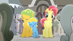 Size: 1366x768   Tagged: safe, screencap, dawn droplet, jasmine breeze, rich harvest, earth pony, pegasus, pony, unicorn, rainbow roadtrip, background pony, building, colored, colt, crowd, cute, desaturated, discovery family logo, family, father and son, female, flower, flower in hair, grayscale, happy, like father like son, like parent like child, male, mare, monochrome, mother and son, raised hoof, sideburns, stallion, thick eyebrows, unnamed pony