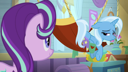 Size: 1920x1080 | Tagged: a horse shoe-in, book, chest, flower, hammock, looking at each other, looking over shoulder, sad, safe, screencap, spoiler:s09e20, starlight glimmer, trixie, trixie's wagon, vase, wagon, window