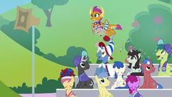 Size: 1920x1080 | Tagged: safe, screencap, berry punch, berryshine, cherry cream, dark moon, final countdown, goldengrape, graphite, pokey pierce, rain dance (character), sir colton vines iii, smolder, sprout greenhoof, team spirit, dragon, earth pony, pegasus, pony, unicorn, 2 4 6 greaaat, spoiler:s09e15, animation error, background pony, background pony audience, baseball cap, bleachers, cap, confetti, dragoness, female, flying, hat, las pegasus resident, male, mare, sitting, smiling, speaker, stallion, unnamed pony