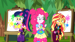 Size: 1916x1080   Tagged: safe, screencap, pinkie pie, sci-twi, sunset shimmer, twilight sparkle, equestria girls, equestria girls series, sunset's backstage pass!, spoiler:eqg series (season 2), canvas, easel, female, geode of sugar bombs, geode of telekinesis, magical geodes, messy, messy hair, outdoors, paint, painting, ponytail, sunset shimmer is not amused, trio, trio female, unamused