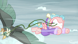 Size: 1280x720 | Tagged: safe, screencap, cozy glow, queen chrysalis, bird, pegasus, pony, roc, frenemies (episode), spoiler:s09e08, disguise, disguised changeling, duo, female, filly, flying, foal, mouth hold, spread wings, wings, winter clothes