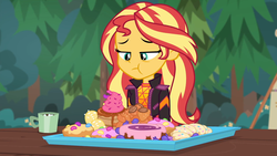 Size: 1920x1080 | Tagged: safe, screencap, sunset shimmer, equestria girls, equestria girls series, wake up!, spoiler:choose your own ending (season 2), spoiler:eqg series (season 2), bread, candy, cheek bulge, chocolate, clothes, croissant, cupcake, donut, eating, female, food, frosting, hot chocolate, jacket, junk food, mouthful, mug, outdoors, pastries, pastry, solo, syrup, table, this will end in diabetes, this will end in tummy aches, this will end in weight gain, this will not end well, tray, waffle, wake up!: pinkie pie