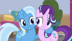 Size: 1920x1080 | Tagged: safe, screencap, starlight glimmer, trixie, pony, unicorn, a horse shoe-in, discovery family logo, eye contact, female, frown, hoof on shoulder, looking at each other, mare, not sure if want, side hug, smiling