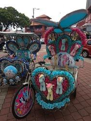 Size: 720x960 | Tagged: safe, photographer:xengk, applejack, fluttershy, pinkie pie, rainbow dash, rarity, twilight sparkle, alicorn, pony, doraemon, female, irl, malaysia, mane six, my little pony logo, photo, plushie, trishaw, twilight sparkle (alicorn)