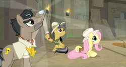 Size: 1600x860 | Tagged: daring do, daring doubt, diamond, doctor caballeron, female, flashlight (object), fluttershy, hat, light show, male, saddle bag, safe, screencap, spoiler:s09e21, sun hat, temple, torch