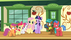 Size: 1366x768 | Tagged: alicorn, biscuit, box, chest, cmc safe, disappointed, door, fluttershy, growing up is hard to do, neckerchief, ribbon, saddle bag, safe, screencap, smiling, spoiler:s09e22, spur, squint, train station, twilight sparkle, twilight sparkle (alicorn), unamused, window