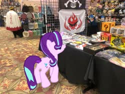 Size: 4032x3024 | Tagged: safe, photographer:undeadponysoldier, starlight glimmer, human, pony, unicorn, augmented reality, convention, dealer room, female, gameloft, ichibancon, irl, irl human, mare, photo, ponies in real life, question mark block, super mario bros.