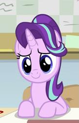 Size: 609x937   Tagged: safe, screencap, starlight glimmer, pony, unicorn, a horse shoe-in, spoiler:s09e20, cropped, cute, desk, female, glimmerbetes, mare, smiling, solo