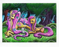 Size: 1024x814 | Tagged: safe, artist:select name, angel bunny, fluttershy, pegasus, pony, unicorn, leak, spoiler:g5, bush, duo, female, flower, flower in hair, fluttershy (g5), forest, g4, g4 to g5, g5, generational ponidox, grass, looking at something, mare, outdoors, prone, redesign, tree, unicorn fluttershy, unshorn fetlocks, vine