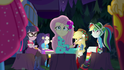 Size: 1920x1080 | Tagged: safe, screencap, applejack, fluttershy, pinkie pie, rainbow dash, rarity, sci-twi, sunset shimmer, twilight sparkle, equestria girls, equestria girls series, sunset's backstage pass!, spoiler:eqg series (season 2), applejack's festival hat, cowboy hat, female, flower, flower in hair, food, glasses, hat, humane five, humane seven, humane six, marshmallow, offscreen character, ponytail, shoes, sitting, sneakers, toasting marshmallows, tree stump, visor