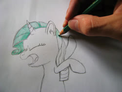 Size: 2828x2121 | Tagged: safe, artist:klystron2010, rarity, human, pony, unicorn, drawn into existence, green mane, hand, irl, irl human, pencil, photo, pure unfiltered evil, sketch, swat, traditional art