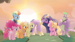 Size: 720x405 | Tagged: safe, screencap, applejack, fluttershy, luster dawn, pinkie pie, rainbow dash, rarity, spike, twilight sparkle, alicorn, earth pony, pegasus, pony, unicorn, the last problem, spoiler:s09e26, horn, looking at each other, mane seven, mane six, needs more jpeg, older, older applejack, older fluttershy, older mane 6, older mane 7, older pinkie pie, older rainbow dash, older rarity, older spike, older twilight, princess twilight 2.0, raised hoof, twilight sparkle (alicorn), wings