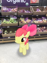 Size: 3024x4032 | Tagged: safe, photographer:undeadponysoldier, apple bloom, earth pony, pony, apple, bow, female, filly, food, fruit, grocery store, in character, irl, photo, ponies in real life, solo, walmart