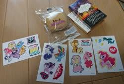 Size: 2048x1393 | Tagged: safe, applejack, fluttershy, pinkie pie, rainbow dash, rarity, spike, twilight sparkle, alicorn, earth pony, pegasus, pony, seapony (g4), unicorn, bread, female, food, hat, irl, mane seven, mane six, mare, photo, riding, sticker, twilight sparkle (alicorn)
