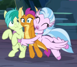 Size: 464x404 | Tagged: safe, screencap, sandbar, silverstream, smolder, dragon, earth pony, hippogriff, pony, uprooted, spoiler:s09e03, cave, cheek to cheek, cropped, cute, diastreamies, dragoness, eyes closed, face to face, female, glomp, hug, lifting, male, raised hooves, small eyes, squishy cheeks, surprise hug, surprised, wings
