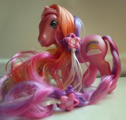 Size: 692x659 | Tagged: safe, photographer:lilcricketnoise, rainbow flash, earth pony, pony, g3, mane clip, palindrome get, smiling, solo, super long hair pony, tail clip, toy