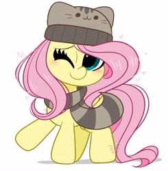 Size: 4012x4096   Tagged: safe, artist:kittyrosie, fluttershy, pegasus, pony, blushing, cap, clothes, cute, hat, looking at you, one eye closed, pusheen, scarf, shyabetes, simple background, solo, white background, winter cap