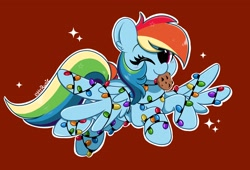 Size: 3200x2176 | Tagged: safe, artist:kittyrosie, rainbow dash, pegasus, pony, christmas, christmas lights, cookie, cute, dashabetes, digital art, female, food, holiday, mare, mouth hold, one eye closed, simple background, smiling, solo, wink