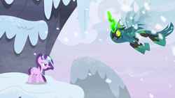 Size: 1280x720 | Tagged: safe, screencap, queen chrysalis, starlight glimmer, changeling, unicorn, the ending of the end, spoiler:s09e25, angry, badass, charging, duo, duo female, fangs, female, fight, flying, forked tongue, glowing horn, gritted teeth, hissing, horn, magic, mountain, open mouth, outdoors, snow, snowfall, tongue out, ultimate chrysalis, wind, windswept mane, wings