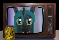Size: 2560x1752 | Tagged: artist needed, source needed, safe, queen chrysalis, 3d, food, irl, looking at you, photo, pickle, solo, television
