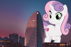 Size: 4189x2793 | Tagged: safe, artist:andoanimalia, artist:jerryakiraclassics19, sweetie belle, pony, unicorn, building, city, female, giant pony, giantess, highrise ponies, irl, looking at you, macro, mare, mega sweetie belle, older, older sweetie belle, photo, ponies in real life, scenery, skyline, smiling, sunset, tree