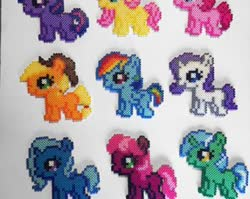 Size: 340x270 | Tagged: safe, applejack, cheerilee, fluttershy, lyra heartstrings, pinkie pie, rainbow dash, rarity, trixie, twilight sparkle, female, filly, filly applejack, filly cheerilee, filly fluttershy, filly lyra, filly pinkie pie, filly rainbow dash, filly rarity, filly trixie, filly twilight sparkle, perler beads, younger